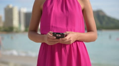 Woman in Pink Dress Using Smart Phone App Stock Footage