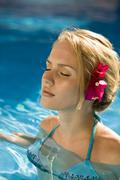 A young woman in a swimming pool - stock photo