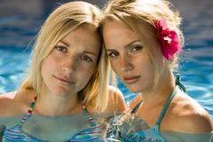 Two women in a swimming pool Stock Photos