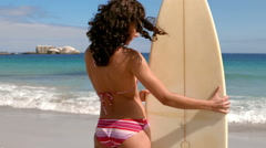Stock Video Footage of Beautiful brunette standing with surfboard
