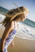 A woman at the beach - stock photo