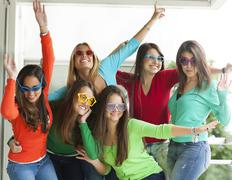 Smiling teenagers with funny glasses Stock Photos