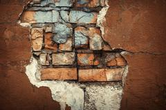 Background of colorful brick wall texture. brickwork. Peeling paint - stock photo