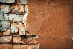 Background of colorful brick wall texture. brickwork. Peeling paint - stock photo