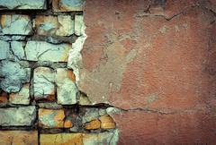 Background of colorful brick wall texture. brickwork. Peeling paint Stock Photos