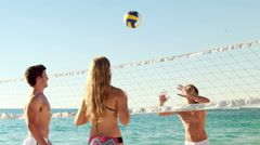 Stock Video Footage of Friends playing beach volleyball