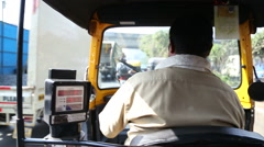 Back view of a local Indian driver of ricksha and charging meter during a ride. Stock Footage
