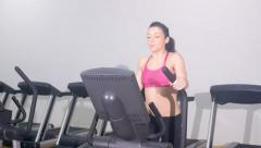 Woman exercising on  cross trainer 4k Stock Footage