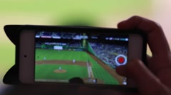 Person at baseball game recording game from smartphone Stock Footage