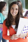 Smiling teenager with exercise books Stock Photos