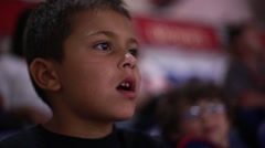 Cute kid watching and enjoying a game from stands Stock Footage