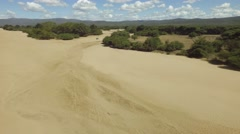 Dry african river bed aerial flyover shot during the dry season Stock Footage