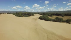 Dry african river bed aerial flyover shot in the dry season Stock Footage