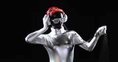 Red Head Nerd Silver Headphones Swinging Stock Footage