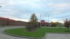 4k time lapse of sunset behind school building - stock footage