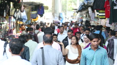 People walking through a crowded street of Mumbai. Stock Footage