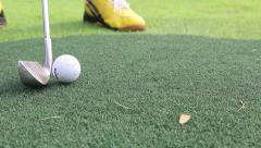 Close-up of basic golfer learning to use putter Stock Footage