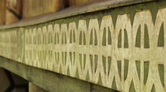 Hand Carved and Painted Trim on Traditional Men's House - PALAU Stock Footage