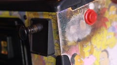 Closeup shot of Pinball Game Being Started Stock Footage
