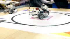 Robots scavenge plastic cups. Stock Footage