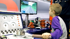 Boy on simulator for training drivers of locomotives and trains Stock Footage