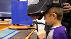 Boy testing simulator for training of welders. Stock Footage
