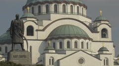 The statue of Karadjordje Petrovic and the Temple of Saint Sava in Belgrade Stock Footage