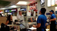 People line up for buying food at food court area Stock Footage
