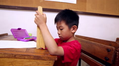Concentrated pupil using abacus Stock Footage