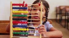 Stock Video Footage of Cute pupil learning maths with an abacus