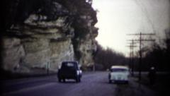 (1950s 8mm Vintage) Cars Passing By Cliff Stock Footage