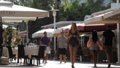 Pretty Girl walking in Lincoln Road, Miami Beach FL Stock Footage