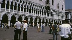 Venice 1974: people walking in front of Palazzo Ducale Stock Footage