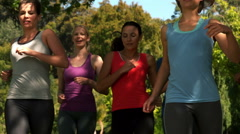 Group of friends doing break after jogging Stock Footage