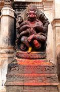 Old deity of Narasimha, the avatar of the Hindu god Vishnu, in a public squar - stock photo