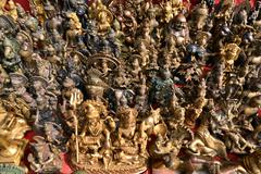 Collection of Buddhist and Hindu god statuettes Stock Photos