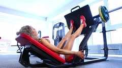 Woman exercising on weightlifting machine Stock Footage