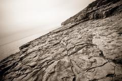 Sepia stone coastline - stock photo
