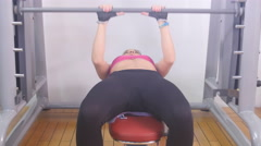 Fit  working out woman lifting weights 4k Stock Footage