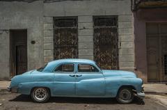 Stock Photo of HAVANA/CUBA 4TH JULY 2006 - Old American cars in the streets of Havana