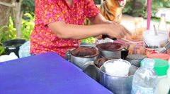 Traditional thai culture Black Coffee and ice in plastic glass made by hand - stock footage