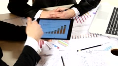 Businessmen consider drawing on the tablet and contract, developing a business Stock Footage
