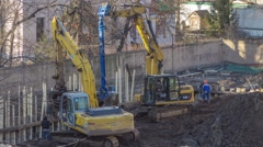 Time Lapse bulding Excavator is raising soil builders using scoop and is digging Stock Footage