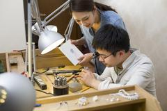 Jewelers making a sapphire ring Stock Photos