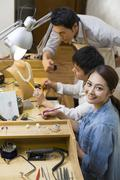 Jewelers working in studio Stock Photos