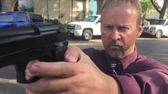 Man with gun 240 frames a second - stock footage