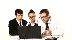 Business team looking at laptop in anticipation completion of the transaction Stock Footage