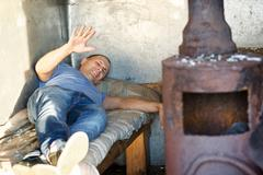 man is in a bad living conditions - stock photo