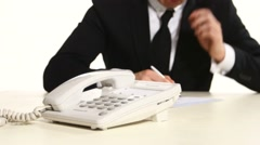 Man's hand dials phone number. In the background planet businessman Stock Footage