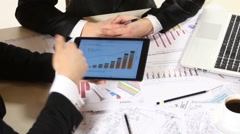 Stock Video Footage of Businessmen consider drawing on the tablet and contract, developing a business